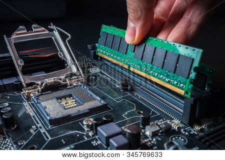 Electronic Engineer Of Computer Technology. Maintenance Computer Hardware Upgrade Of Motherboard Put