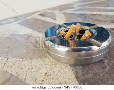 Cigarette Stub Butt Disposal At The Garbage Bin. People Are Addicted, Try To Quit Smoking And It Can