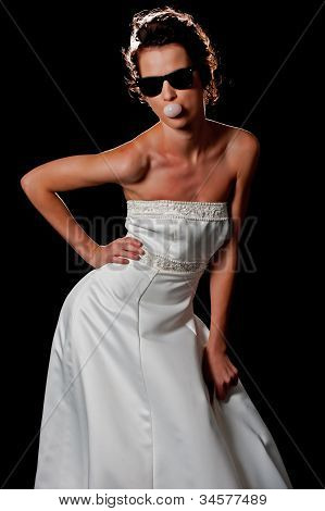 Bubble gum and Sunglasses in a bridal dress