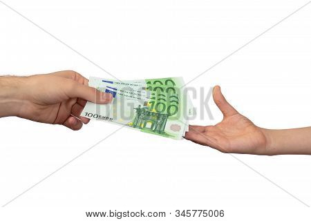 An Adult Pays A Child Paper Money. The Concept Of Inheritance Transfer Or Payment For Minor Labor. E