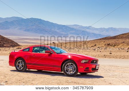 Death Valley, California Usa- 02 June 2015: Red Ford Mustang On The Artist Dr. Desert Salt Pan In Th