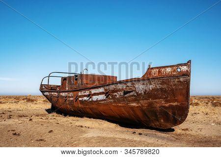 Abandoned Boat In Desert Close To Akbasty In Aral Sea Or Aral Lake, Kazakhstan