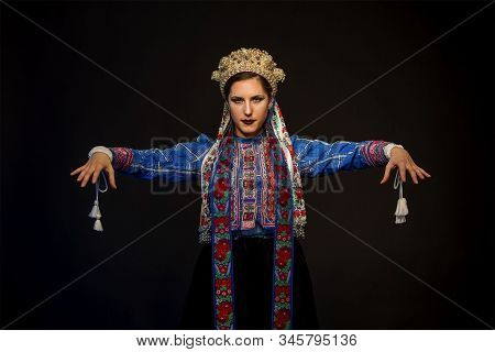 Young Brunette In Folk Clothes And Pearl Corolla