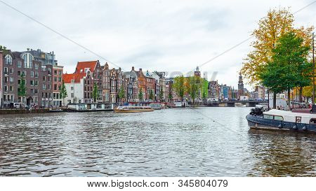 Amsterdam, Netherlands 15 October 2019. Amsterdam Canals With Boats And Houses.
