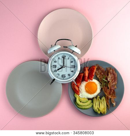 Intermittent Fasting Concept With Empty Colorful Plates. Time To Lose Weight , Eating Control Or Tim