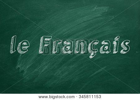 """le Francais"" Written With Chalk On Green Chalkboard"