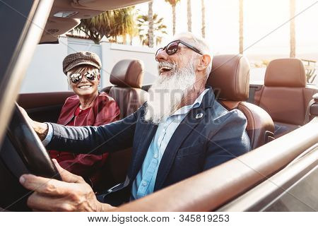 Happy Senior Couple Having Fun On New Convertible Car - Mature People Enjoying Time Together During
