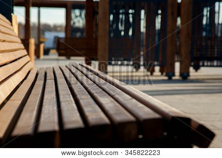 Stylish Park Bench. Wooden Bench Outdoors. Park Benches On A Late Autumn Day.