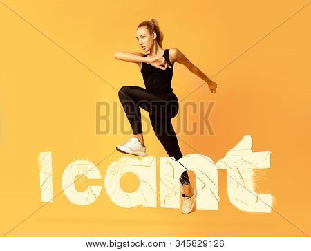 Motivated Fitness Girl In Black Sportswear Stepping On White I Cant Lettering Over Yellow Background
