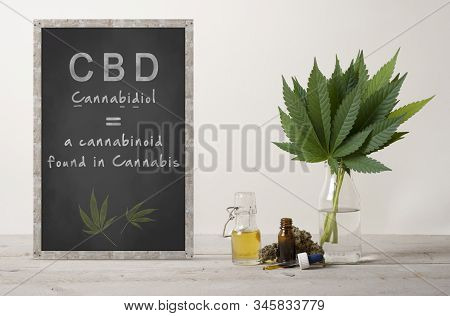 Rustic Blackboard With Text Cannabidiol And Marujuana Cannabis Sativa Weed Leaves Bouquet, Flower Bu