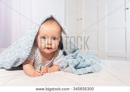 Cute Baby Infant Boy Crawl Out Of Towel With Happy Positive Face Expression Playing In Home Bedroom