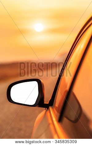 Mock Up Side View Mirror Of Car On Road In Autumn Sunset For Travel, Car Insurance Or Roadside Assis