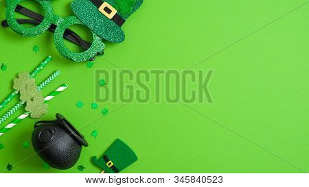 St Patricks Day Banner Design. Top View Pots Of Gold, Drinking Straws With Shamrock Four Leaf Clover