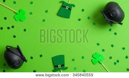 St Patricks Day Frame Of Leprechaun Hats, Shamrocks, Pots Of Gold And Confetti. Saint Patrick's Day