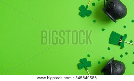 St Patrick's Day Background With Pots Of Gold, Shamrock Four Leaf Clover And Leprechaun Hat On Green