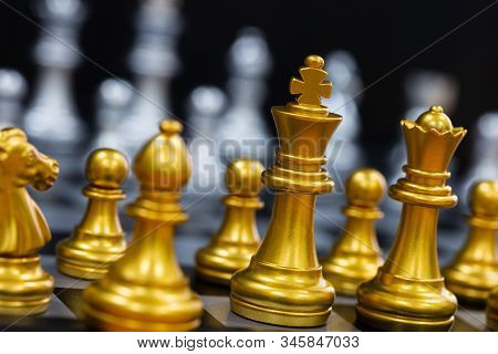 The King In Battle Chess Game Stand On Chessboard With Black Isolated Background. Business Leader Co