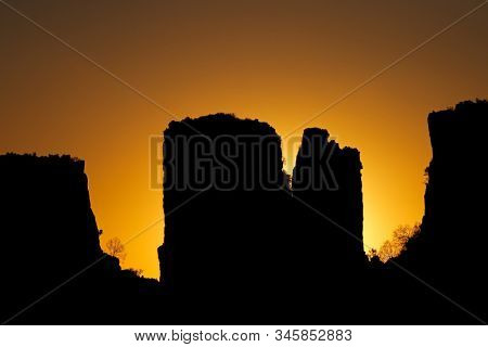 Rock silhouettes at sunset, Valley of desolation, Camdeboo National Park, South Africa