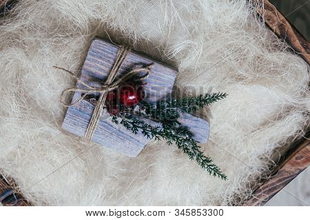 Stock Photo - Christmas Wooden Board With Snow Fir Tree And Decor