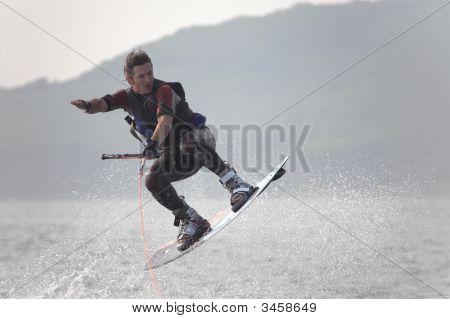 Flying Wakeboarder In Water Splash