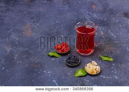 Red Tea (rooibos, Hibiscus, Karkade) In Turkish Tea Cup (armudu) With Dogwood, Raisins, Sugar In Ori
