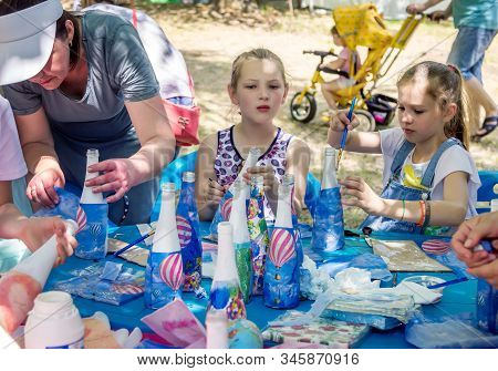 Zaporizhia/ukraine-june 1, 2019: Children And Their Parents Participating At Art And Craft Outdoors