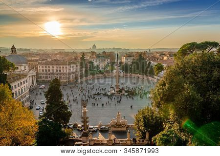 Rome / Italy - December 2 2018: View Of Piazza Del Popolo In The Evening, With The Vatican Dome In T