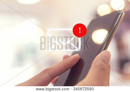 Woman Hand Use Smartphone In Public Area With 1 New Email Alert Sign Icon Pop Up. Communication Busi