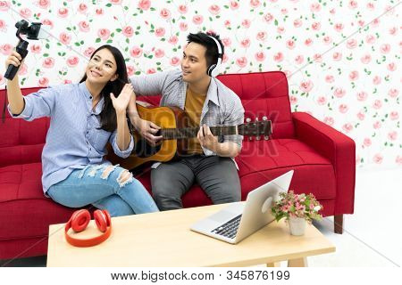Duo singer do vlog live singing song with guitar to share on social media. Using for vlog social media influencer concept.