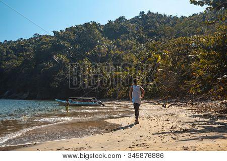 Strolling On The Beautiful Puerto Caribe Beach In Punta De Sal In The Caribbean Sea, Tela. Honduras
