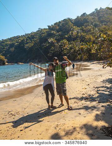 A Couple On The Beach Of Puerto Caribe In Punta De Sal In The Caribbean Sea, Tela. Honduras