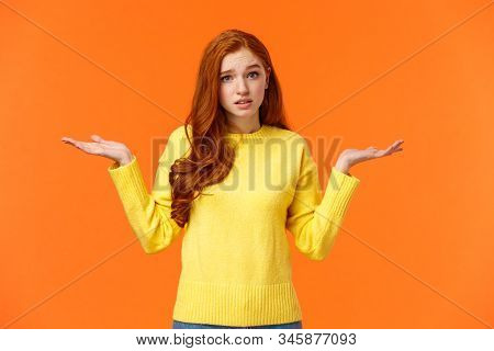 Perplexed Cute Redhead Girl, Shrugging With Raised Arms And Looking Confused, Dont Know Answer, Cant