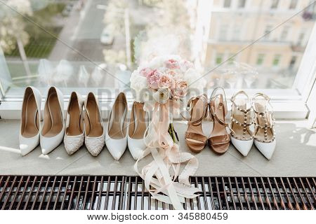 Woman Round-toe Pumps Shoes Collection And Roses Flowers Bouquet Standing On Windowsill. Bridal Flor