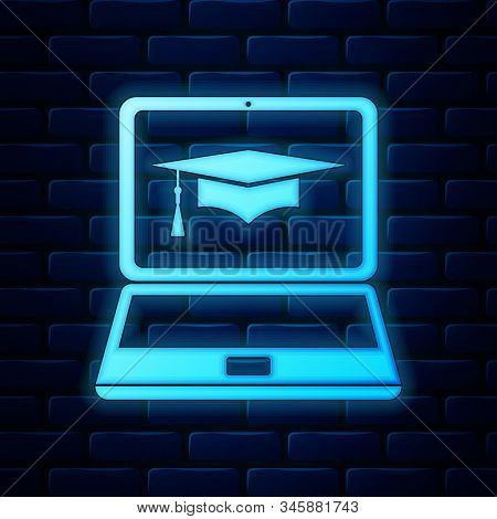 Glowing Neon Graduation Cap And Laptop Icon. Online Learning Or E-learning Concept Icon Isolated On