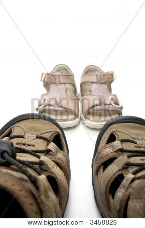 Big male and small baby walking sandals isolated on white background poster