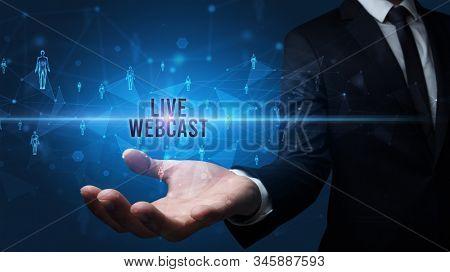 Elegant hand holding LIVE WEBCAST inscription, social networking concept