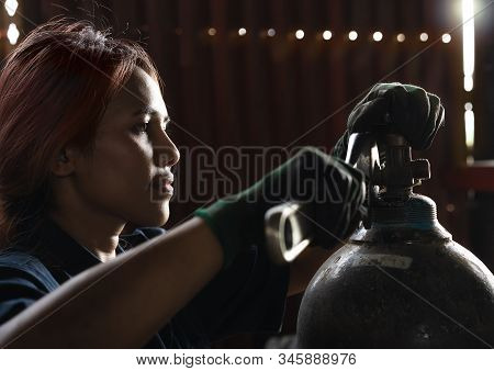 Female Apprentice Industrial Engineer, Inspecting And Maintaining Compressed Gas Cylinders In Produc