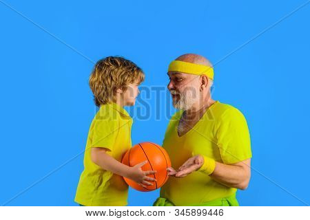 Grandfather Teaching Grandson To Play Basketball. Family Time. Grandfather And Kid Playing. Family S