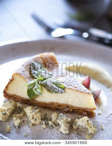 Cheesecake With Strawberry And  Dorblu Cheese On A Plate. Closeup