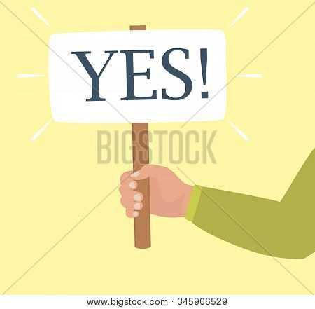 Concept Of Consent. A Human Hand In Green Shirt Holds A Board Saying Yes. Symbol Of Decision Making,