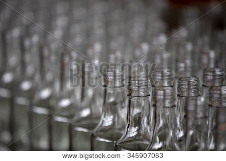 Glassworks. Glass Industry. Many Glass Bottles On A Factory Conveyor.