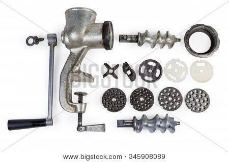 Completely Disassembled Old Hand Meat Grinder, Its Component Parts And Interchangeable Parts For Dif