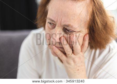 Portrait Of Depressed Elderly Woman Having Worries,  She Worries, She Thinks