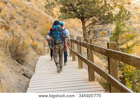 Terrebonne, Oregon, Usa - October 22, 2018: Climbers Pass Over One Of The Wooden Footbridges Of One