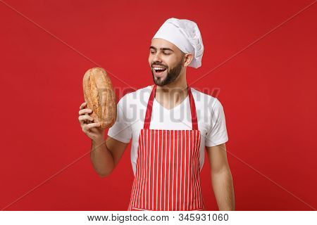 Cheerful Young Bearded Male Chef Cook Or Baker Man In Striped Apron White T-shirt Toque Chefs Hat Is