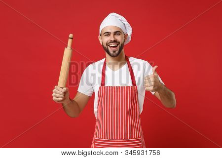 Joyful Young Male Chef Cook Or Baker Man In Striped Apron White T-shirt Toque Chefs Hat Posing Isola