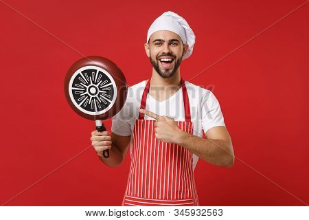 Funny Young Male Chef Cook Or Baker Man In Striped Apron White T-shirt Toque Chefs Hat Posing Isolat