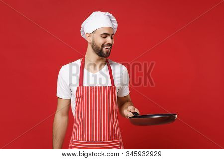 Smiling Young Bearded Male Chef Cook Or Baker Man In Striped Apron White T-shirt Toque Chefs Hat Pos