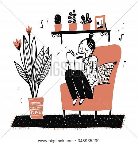 The Girl Sits Reading Her Favorite Book On Her Favorite Sofa.moments Of Relaxation The Appearance An