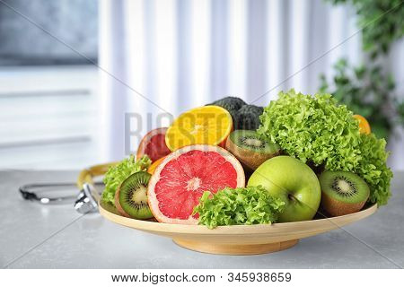 Plate Of Fruits On Table. Diet Plan From Nutritionist