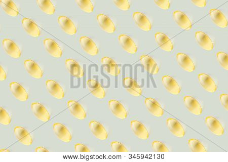 Transparent yellow vitamin capsules on a light pastel background. The concept of health, beauty. Vitamin E, omega-3, vitamin D3, fish oil. Top view, minimalism, copy space. poster